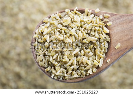 Healthy Freekeh in wooden spoon.