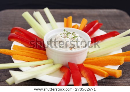 Healthy French onion dip with caramelised onion, Greek yogurt and fresh herb thyme with fresh vegetables. - stock photo