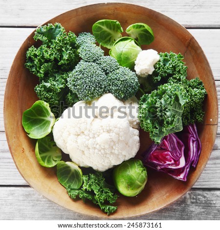 Healthy Fresh Broccoli, Cauliflower and Cabbage Vegetables on Wooden Bowl, Placed on Wooden Table - stock photo