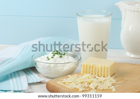 Healthy, fresh dairy products include cottage cheese, swiss cheese and a glass of milk
