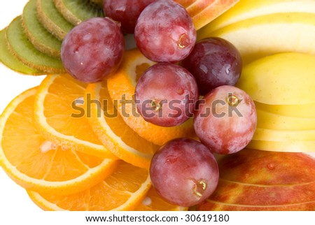 Healthy fresh fruits background with orange, kiwi, grapes and apple - stock photo