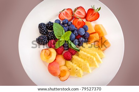 Healthy fresh fruits in a plate - stock photo