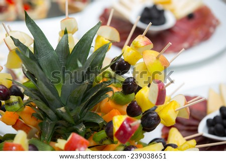Healthy fresh fruits on a stick - stock photo