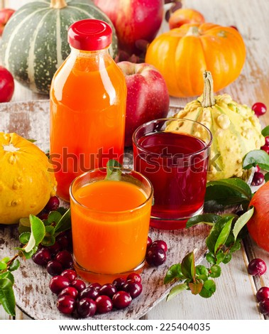 Healthy fresh Juices, fruits  and vegetables - autumn still life. Selective focus - stock photo