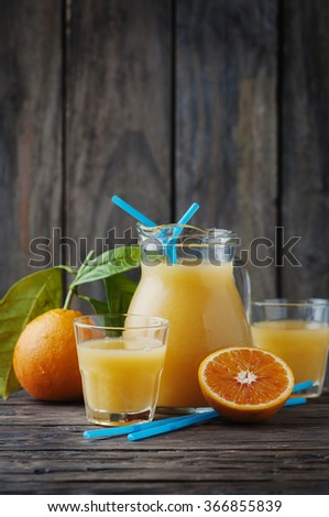 Healthy fresh orange juice on the woodent table, selective focus - stock photo