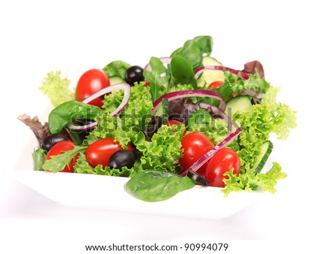 Healthy fresh salad over white