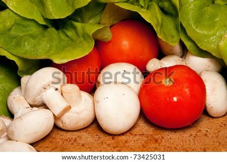Healthy fresh vegetables: tomatoes, mushrooms, lettuce - stock photo