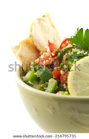 Healthy fresh vegetarian tabbouleh salad with pita chips