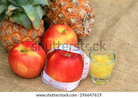 Healthy fruit and tape measure. - stock photo