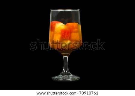 Healthy Fruit Cocktail with Papaya, Pineapple, and Grapefruit Isolated on a Black Background