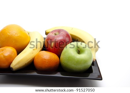 Healthy fruit on black plate