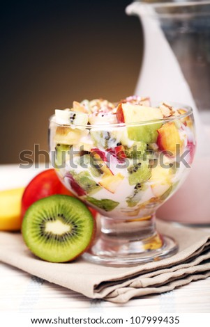 Healthy fruit salad with yoghurt - stock photo