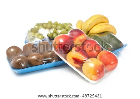 healthy fruits on white in packages - stock photo