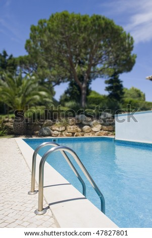 healthy garden and a refresh water pool at a villa (Algarve, south of Portugal) - stock photo