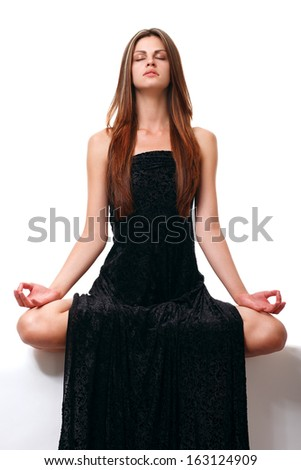 healthy girl doing yoga. isolated - stock photo