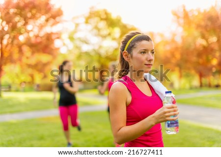 Healthy girl holding a water bottle  - stock photo