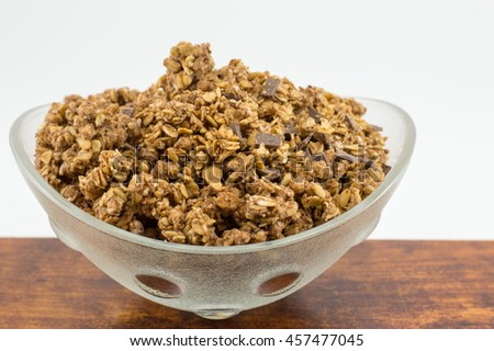 Healthy granola muesli cereals with chocolate in a bowl - stock photo