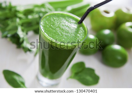 Healthy green celery, apple and lime juice - stock photo
