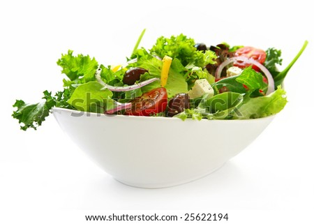 Healthy green salad, in stylish white bowl.  Isolated on white. - stock photo