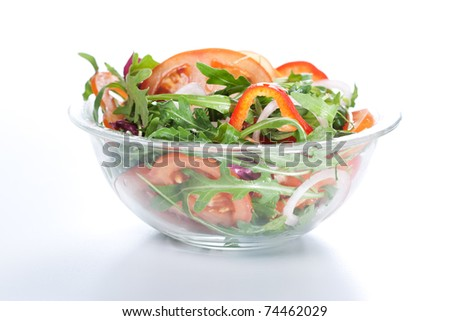 Healthy green salad, with tomatoes, pepper, onion and rucola. - stock photo