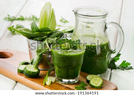 Healthy green smoothie on a wooden table. Selective focus - stock photo