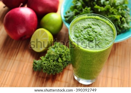 Healthy green smoothie with kale, apple and fresh lime in a glass - stock photo