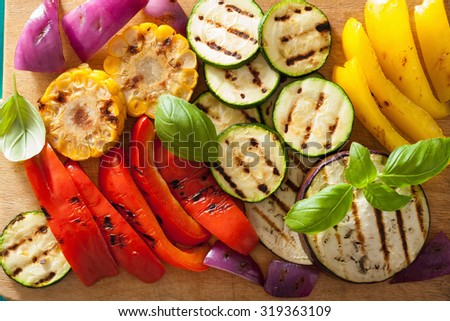 healthy grilled vegetables on chopping board - stock photo