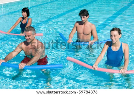 Healthy group of people exercising with aqua tube in a swimming pool - stock photo