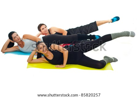 Healthy group of three people doing gym and sitting on colorful mats isolated on white background - stock photo