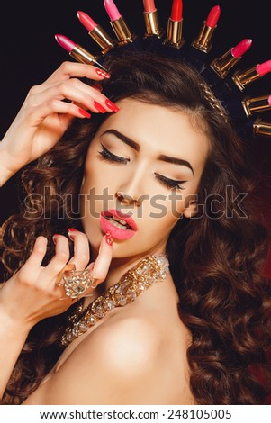 Healthy Hair and Beautiful Professional Makeup. Red Lips and Smoky Eyes Make up. Gorgeous Glamour Lady Portrait. Haircare, Skincare concept. Woman in lipstick crown. Red lipstick. - stock photo