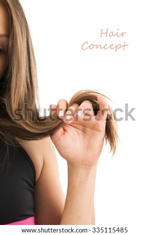 healthy Hair Growth concept. Portrait of beautiful young woman holding her long hair on white background