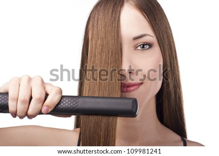 Healthy Hair. Hairstyling. Hairdressing. Hair Straightening Irons.Beautiful Woman with Long Straight Hair - stock photo