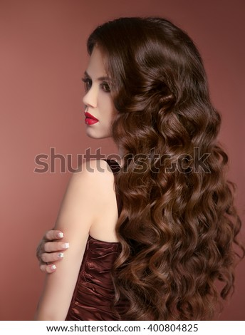 Healthy Hair. Wavy Hairstyle. Beauty girl fashion portrait. Beautiful young woman with long curly hairs - stock photo