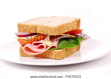Healthy ham sandwich with cheese, tomatoes on white background - stock photo