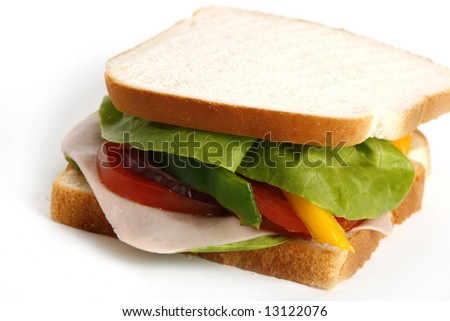 Healthy ham sandwich with tomatoes and lettuce