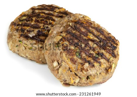 Healthy hamburger patties, isolated on white.  Grilled beef mixed with grated vegetables, including carrot and zucchini or courgette. - stock photo