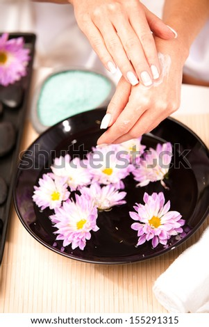Healthy Hands.Female applying moisturizer to her Hands