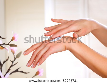 Healthy Hands.Female applying moisturizer to her Hands after bath.Skincare concept - stock photo