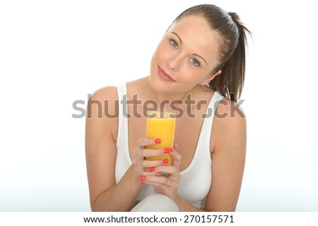 Healthy Happy Attractive Fit Young Woman Holding a Glass Of Fresh Organic Orange Juice