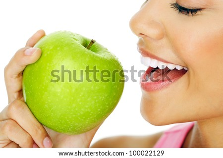Healthy happy woman eating apple close macro - stock photo