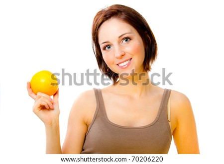 Healthy happy woman holding and orange
