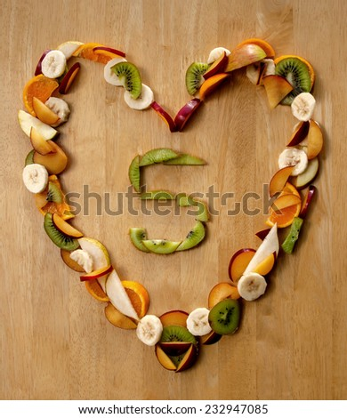 Healthy Heart ...?! Eat 5 a Day! Fresh fruit design for a good heart and health - eating 5 portions of fruit & veg a day for good nutrition, health care, a healthy heart and a good diet. - stock photo