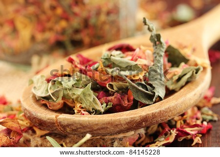 Healthy herbal dry Tea with rose petals (shallow dof) - stock photo