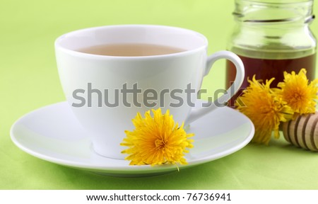 Healthy herbal tea made from freshly picked dandelions with honey - stock photo