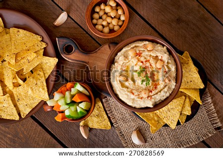 Healthy homemade  hummus with vegetables, olive oil and pita chips  - stock photo