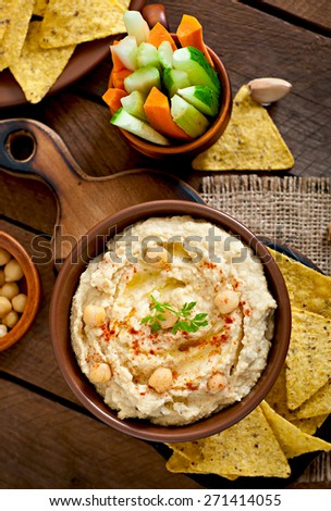 Healthy homemade hummus with vegetables, olive oil and pita chips.Top view  - stock photo