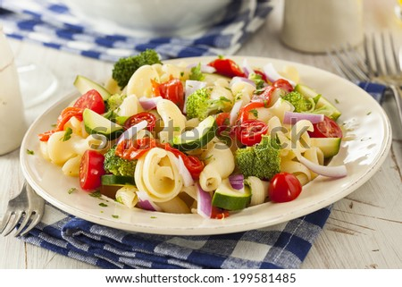 Healthy Homemade Pasta Salad with Tomatoes Onions and Broccoli - stock photo