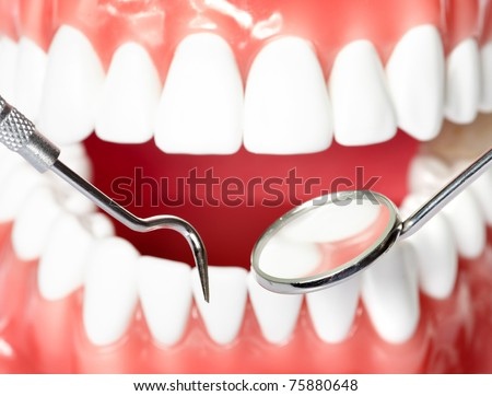 Healthy human teeth and a dentist mouth mirror