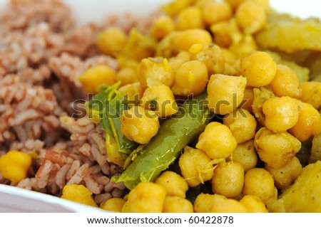 Healthy Indian vegetarian set meal with unpolished red rice. Concepts such as food and beverage, and travel and cuisine, and diet and nutrition.