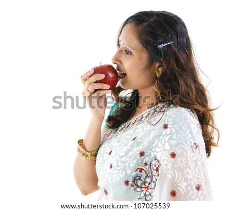 Healthy Indian woman eating red apple, isolated on white background - stock photo